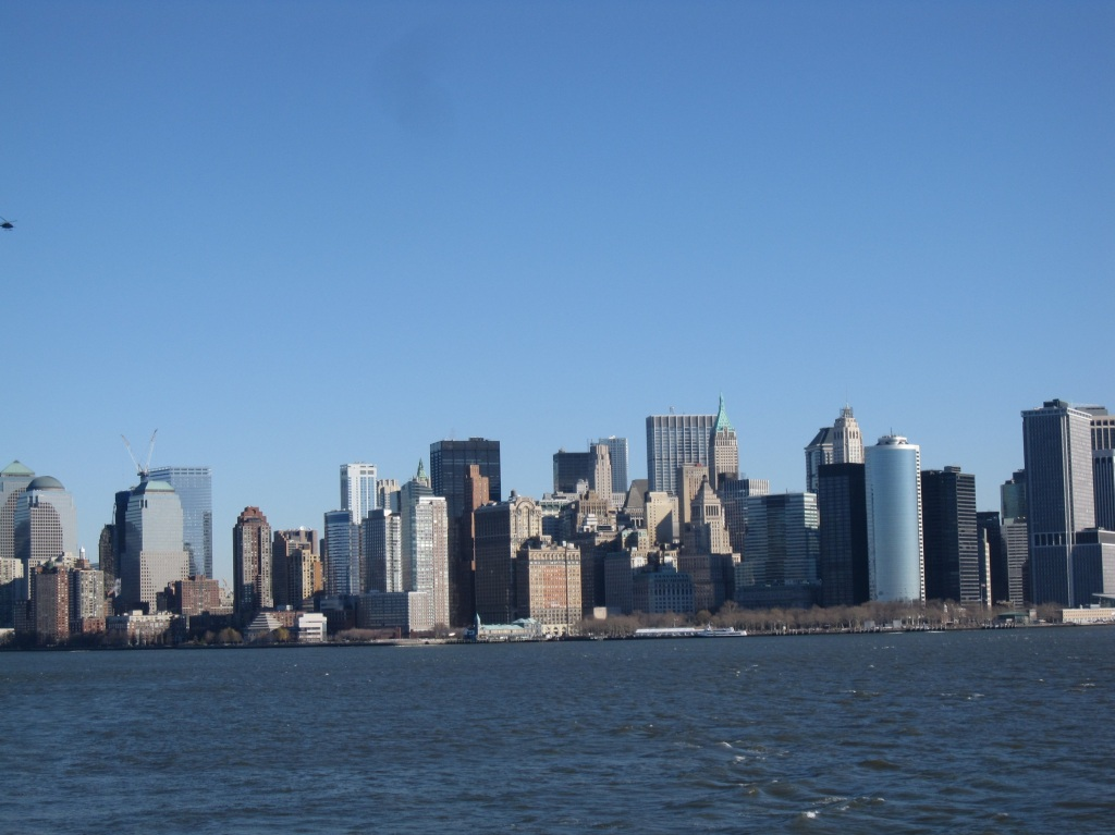 Skyline Manhattan from water sun